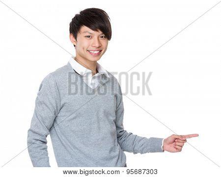 Businessman showing finger point aside