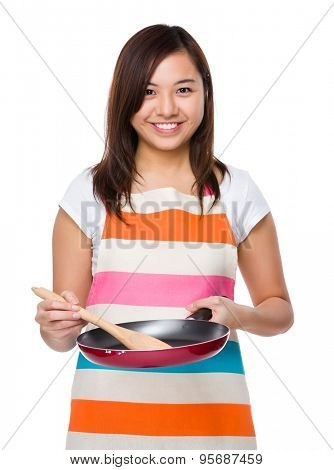 Housewife cooking with frying pan