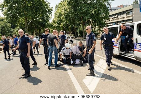 Police arresting man at protest