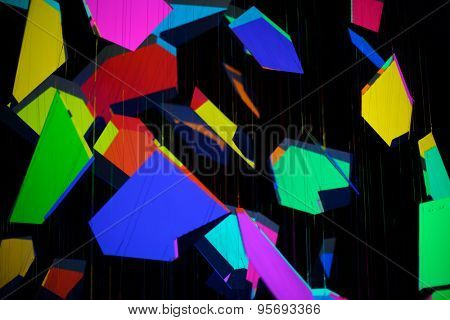 Abstraction, different colored geometrical figures on a black background