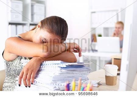 Office life. Young woman sleeping at workplace