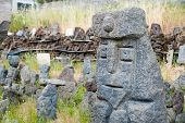 picture of stone sculpture  - Grey lava stone sculpture of an old king - JPG