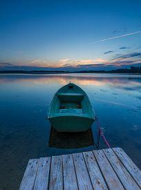 stock photo of dock a lake  - Beautiful lake sunset with fisherman boats - JPG