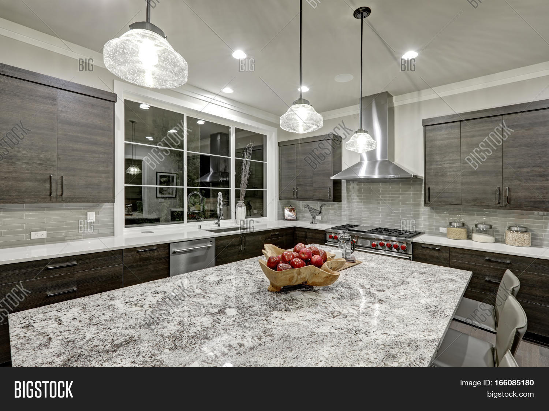 Modern traditional kitchen design in new luxury home stock for Modern kitchen in traditional house
