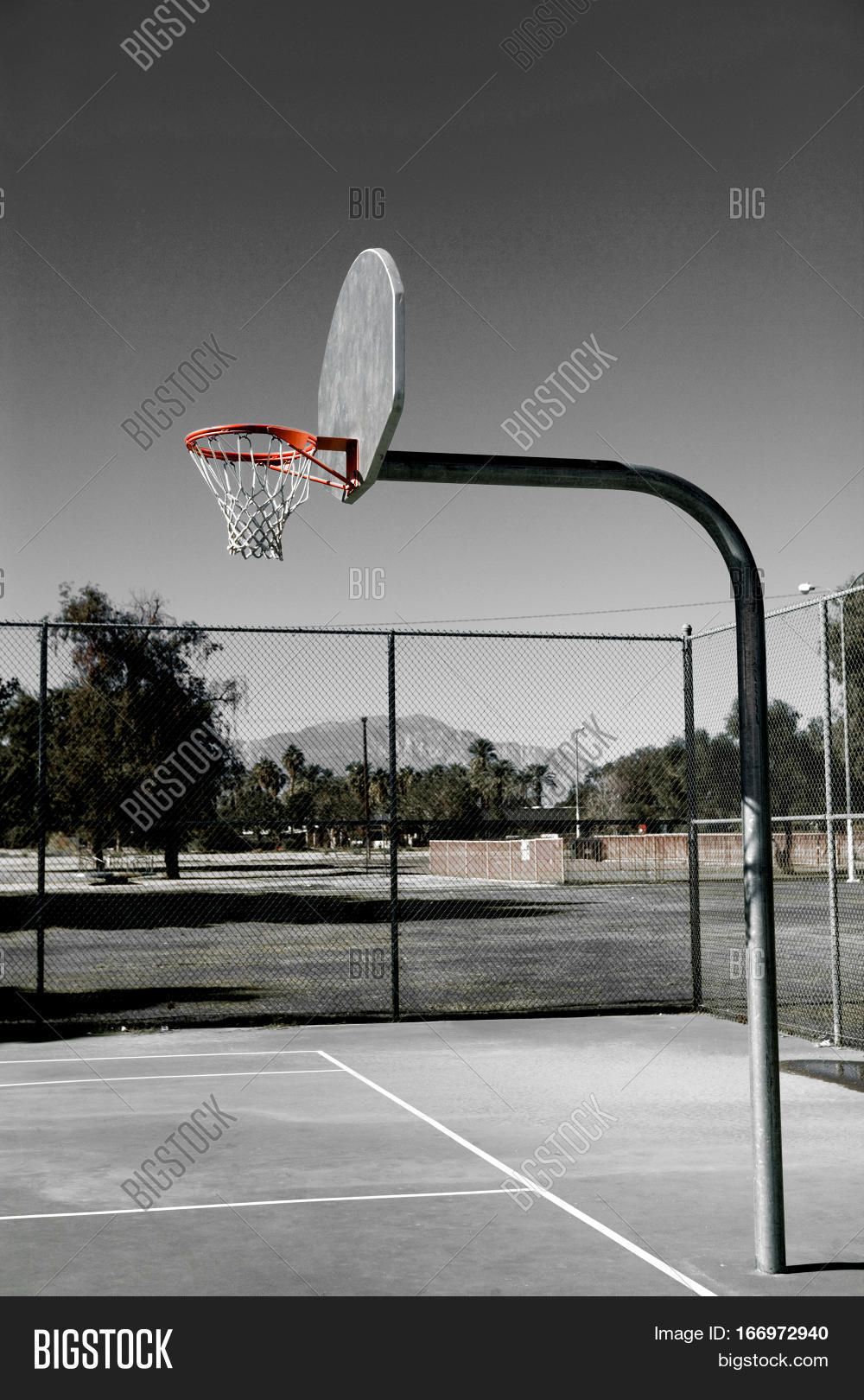 Playground basketball court stock photo stock images for How big is a basketball court