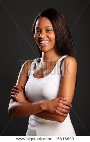 Laughing black woman in white vest