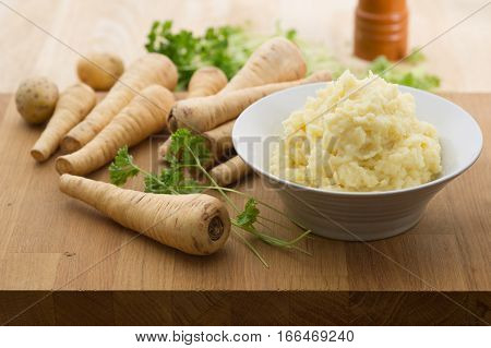 Homemade parsnip and potato mash with parsley.