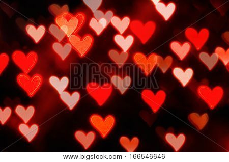 St Valentines Day red heart bokeh background - St Valentines day concept with defocused light hearts. Colorful St Valentines day background. Bokeh St Valentines day background with red hearts