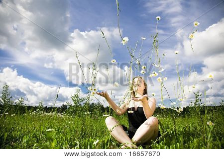 Daisy Rain. Woman Playing With Flowers.