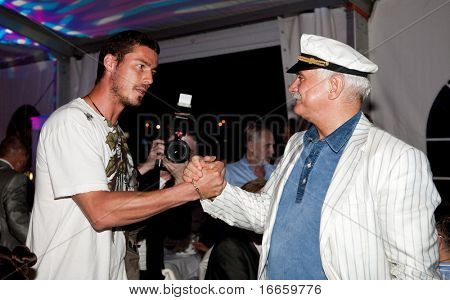 MOSCOW - JUNE 28: Tennis player Marat Safin And President Of Festival Nikita Mikhalkov at the afterparty of 31st Moscow International Film Festival at Neskuchnyi Garden. June 28, 2009 in Moscow, Russia.