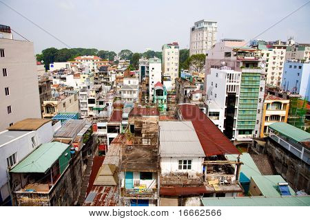 Colorful and chaotic houses in the city center. Ho Chi Minh City, Vietnam