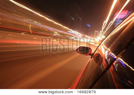 fast car through downtown at night