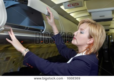 Stewardess Checking Luggage Box