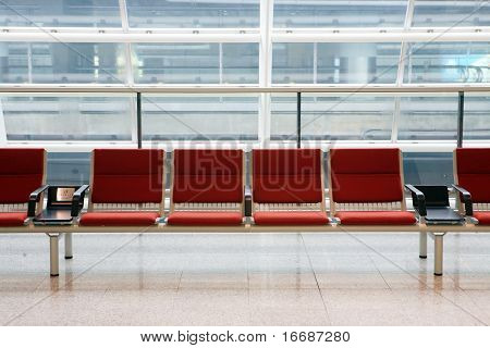 row of red chair at airport in Hongkong