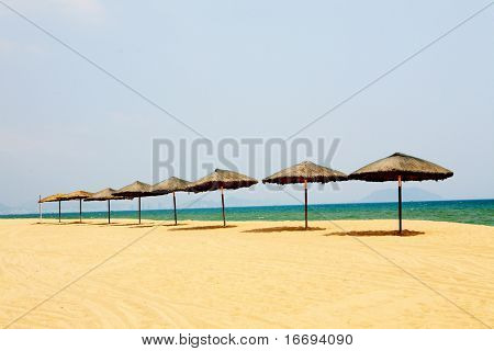 Sunshade and chairs on beach, Sanya, China
