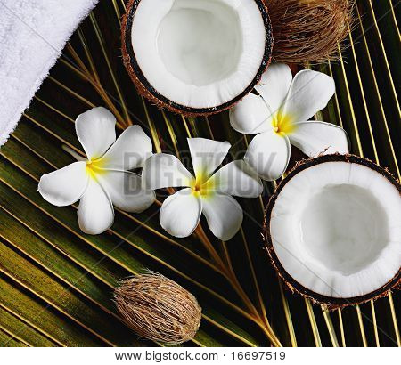 spa objects coconuts flowers towel on palm leaf