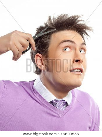 attractive man close up portrait on white background cutting his hairs