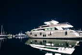 Luxury Yachts In La Spezia Harbor At Night With Reflection In Water. Italy poster