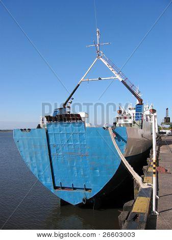 Cargo carrier in dock. Paraguay river, Asuncion