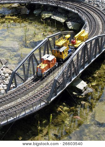 Miniature locomotive crossing bridge