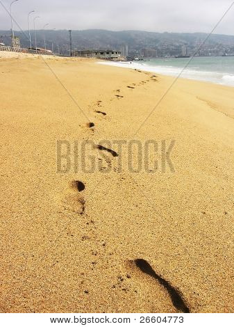 Footmarks on sandy beach of Valparaiso, Chile