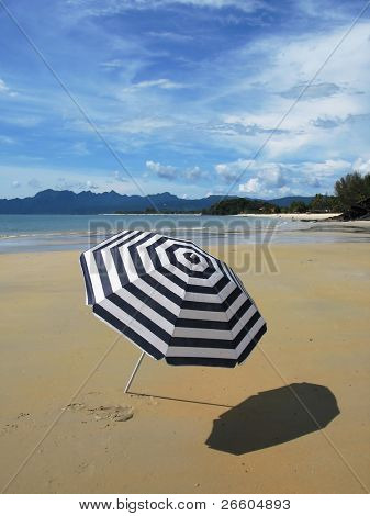 Sun umbrella on a secluded beach of Langkawi, Malaysia