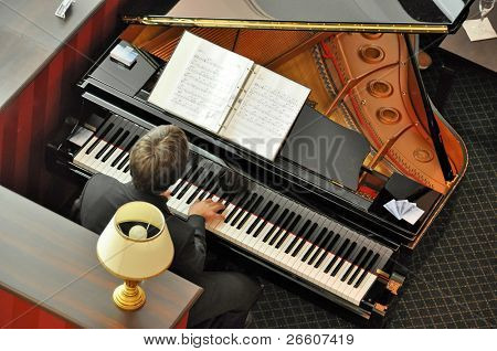 Musician at piano in lounge