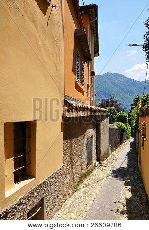 Narrow street of Menagio town at the famous Italian lake Como