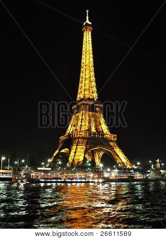 PARIS - APRIL 4: Eiffel tower at night on April 4, 2010 in Paris. Eiffel tower is the most visited monument of France