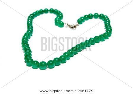 Green Bracelet On The White Isolated Background