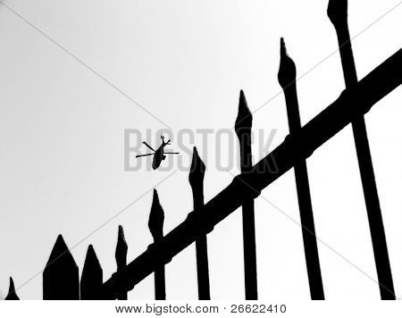 Military helicopter in mission of war and barbwire