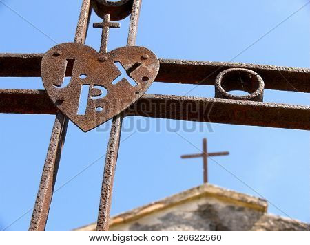 Maletto iron crosses rusty of the monk passionisti and their christian symbol with acronym