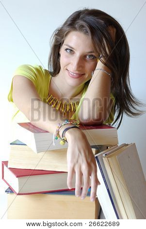 Girl student and pile of book