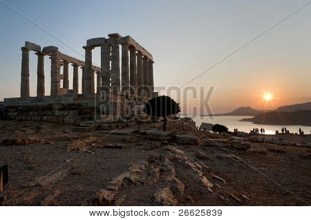 temple of Poseidon on coast of cape Sounion at the sunset