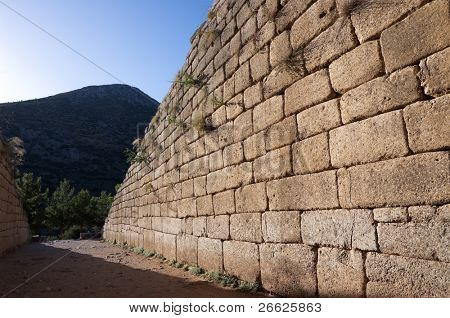 wall Cyclopean, constituting a primitive style of masonry characterized by the use of massive stones of irregular shape and size