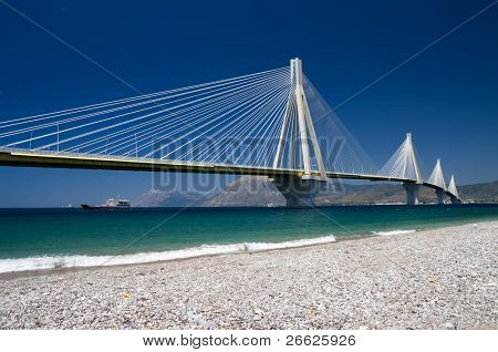 suspension bridge crossing Corinth Gulf strait, Greece.  Its official name is the Charilaos Trikoupis Bridge. The lead architect was Berdj Mikaelian. Is the world's second longest cable-stayed deck;