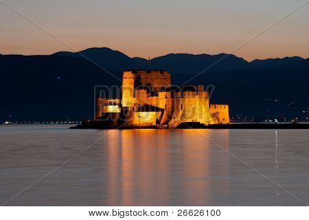 view by night of castle of Bourtzi on the island in the bay of Nauplia at twilight