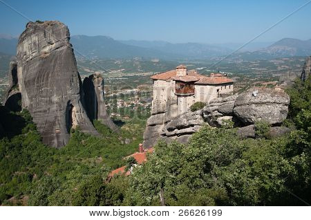 view of Moni Agias Varvaras Roussanou and cliff of Meteora, Greece