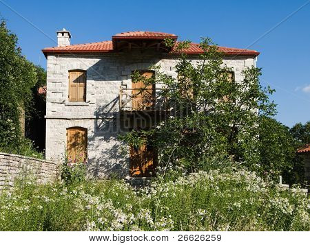 front view of beautiful house with uncultivated garden