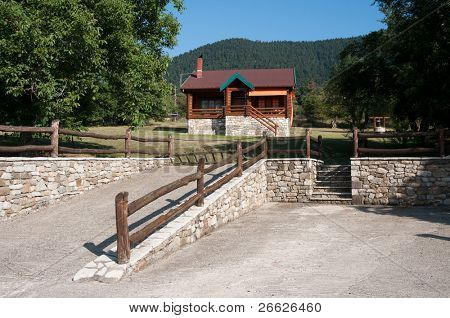 front view of log cabin in land considered the Swiss Alps of Greece