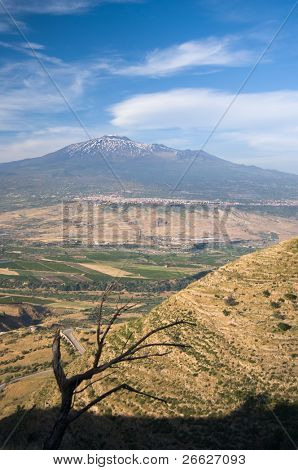 vertical composition of sicilian hinterland on background cultivated land and volcano Etna