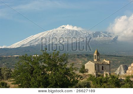 an small chapel in the sicilian countryside under the majestic volcano Etna