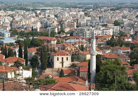 the minaret in the old city of Xanthi on the background the new city