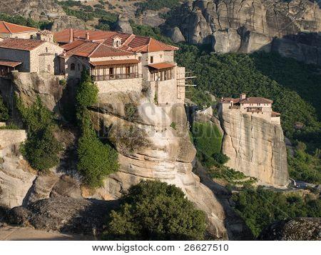 The Holy Monastery of Great Meteoron on background Moni Agias Varvaras Roussanou, Greece