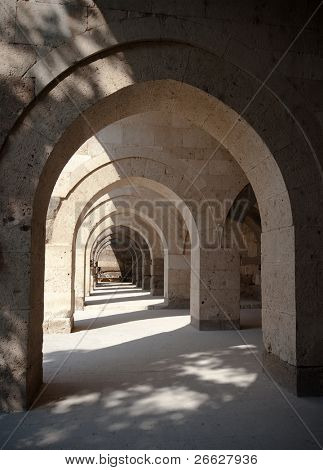 multiple arches and columns in the Sultanhani caravansary on the Silk Road, Turkey