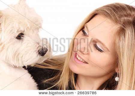 Attractive happy young woman with dog, isolated on white background