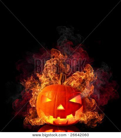 Evil burning halloween pumpkin isolated on black background