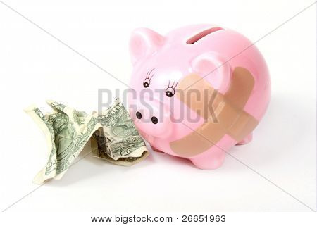 Hurt piggy bank with wrinkled dollar
