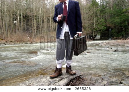 Business Man Drinks Coffee In The Woods