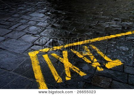Taxi sign on rainy street